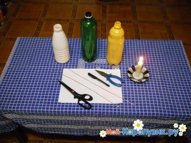 Изготовление ромашки из пластиковых бутылок - фото 1